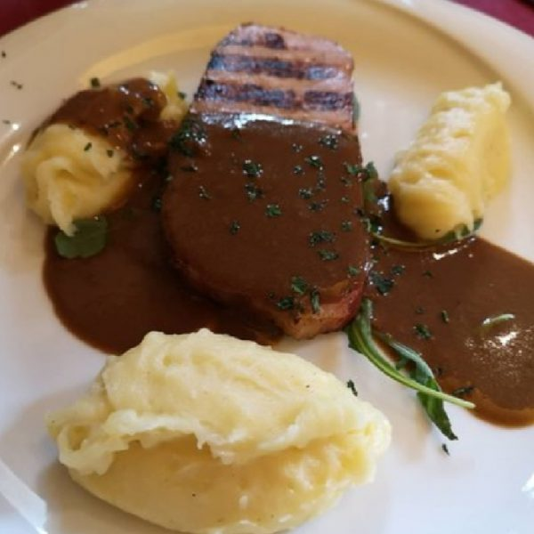 Smoked pork loin with mustard sauce and mashed potatoes